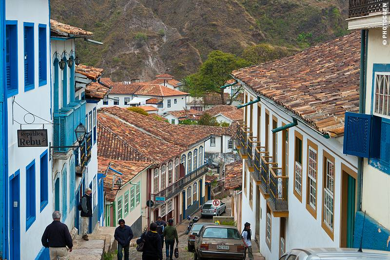 Ouro Preto on Foot, here a narrow street lined with colorful houses.