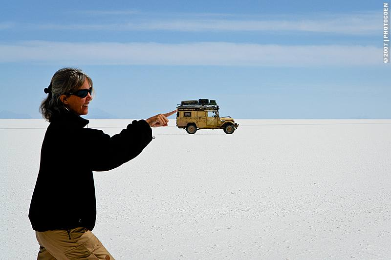 Driving on Salar de Uyuni, optical illusion photo of Karin-Marijke full sized pushing the Land Cruiser mini-sized
